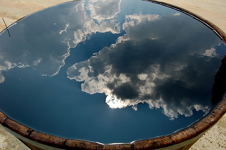 a bucket full of cloudy sky by Ermolaos